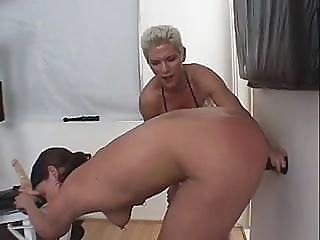 Muscular dyke fucks submissive chick with strap on during work out blonde brunette sex toy