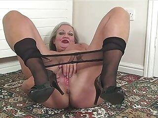 Granny April undresses together with savorily jerks off her old cunt fingering mature stockings
